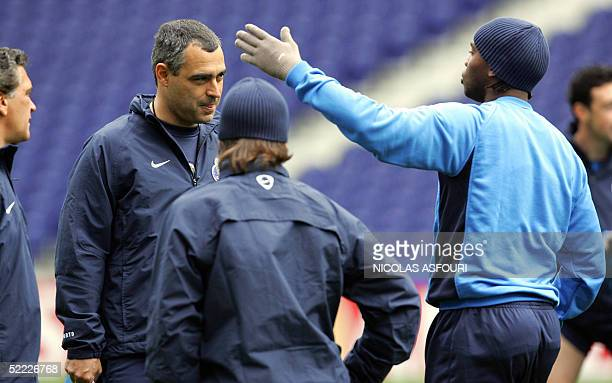 Porto striker Benni McCarthy speaks with Porto's head coach Jose Couceiro during a training session on the eve of their Champions league football...