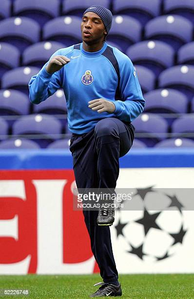Porto striker Benni McCarthy warms up during a training session on the eve of their Champions league football match against Inter Milan at the Dragon...
