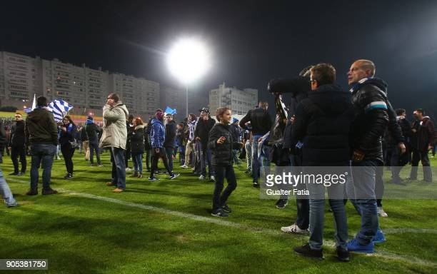 Porto supporters in the pitch after evacuating the stands for security reasons during the Primeira Liga match between GD Estoril Praia and FC Porto...