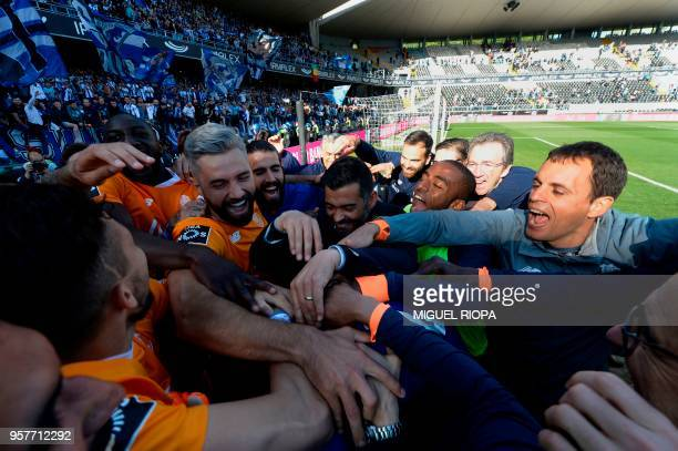 FC Porto team celebrate at the end of the Portuguese league football match between Vitoria SC and FC Porto at the Afonso Henriques stadium in...