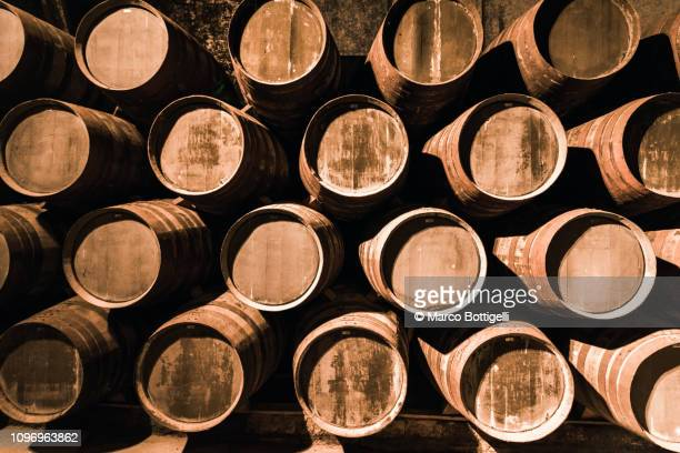 porto wine barrels in a wine cellar of porto, portugal - winery stock pictures, royalty-free photos & images