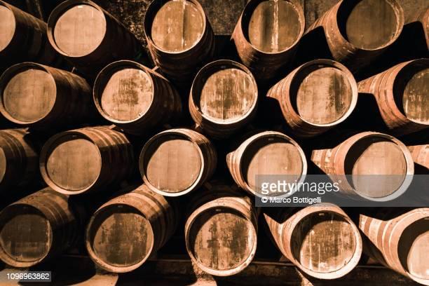 porto wine barrels in a wine cellar of porto, portugal - ワイナリー ストックフォトと画像