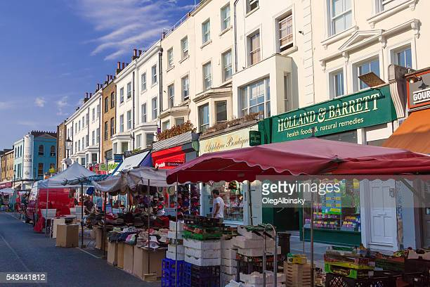 Portobello Road Market lined with Stores, Notting Hill, London, England.