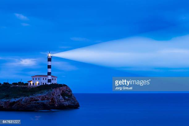 portocolom lighthouse - lighthouse stock pictures, royalty-free photos & images
