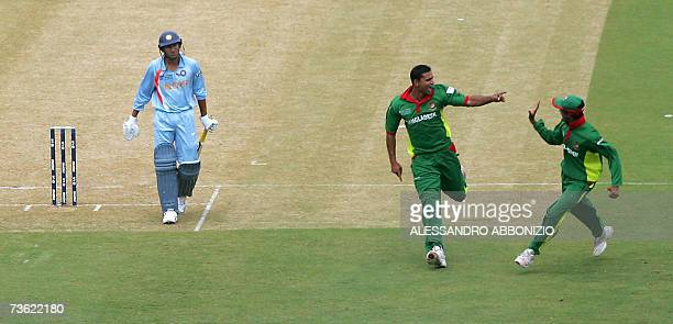 Bangladeshi cricketer Mashrafee Mortaza celebrates after dismissing Indian batsman Agit Agarkar at the Queen's Park Oval in the Port of Spain in...