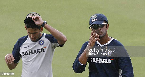 India Cricket Captain Rahul Dravid and Ajit Agarkar gestures during a training session at the Queen's Park Oval stadium in the Port of Spain 22 March...