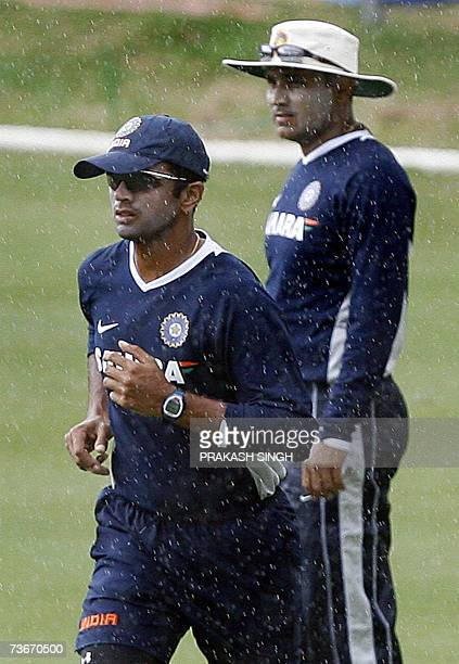 India Cricket Captain Rahul Dravid and Virendra Sehwag warm up as it rains during training session at the Queen's Park Oval stadium in the Port of...