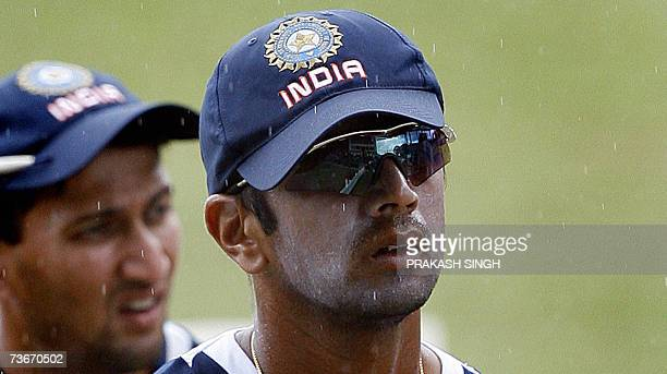 India Cricket Captain Rahul Dravid walks back to the pavillion as it rains during a training session at the Queen's Park Oval stadium in the Port of...