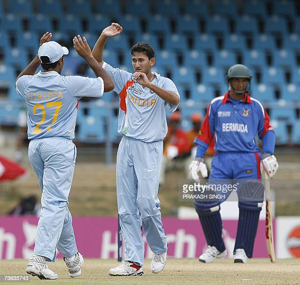 India cricketer Robin Uthappa congratulates Ajit Agarkar for the wicket of Bermuda's Lionel Cann during their Group B World Cup match at the Queen's...