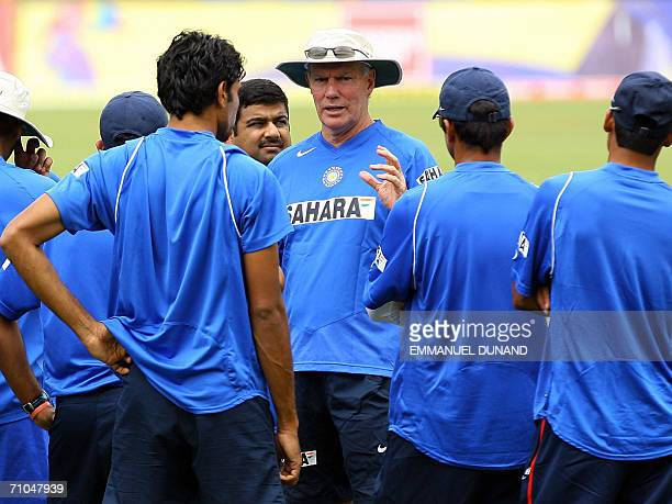 Port-of-Spain, TRINIDAD AND TOBAGO: Indian cricket players listen to coach Greg Chapell during a training session at Queen's Park cricket oval in...