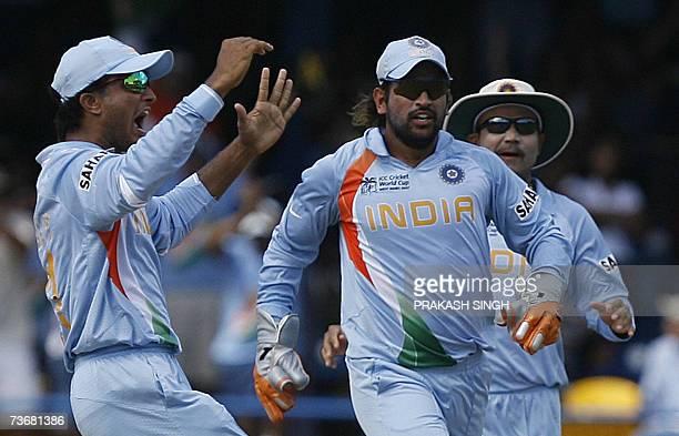 Indian cricketers Saurav Ganguly Mahendra Singh Dhoni and Virendra Sehwag celebrate the wicket of Sri Lankan batsman Sanath Jayasuriya off Zaheer...