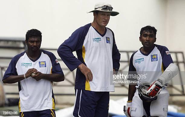 Sri Lanka Cricket captain Mahela Jayawardene talks with Coach Tom Moody as Muttiah Muralitharan waits for his turn to bowl during the training...