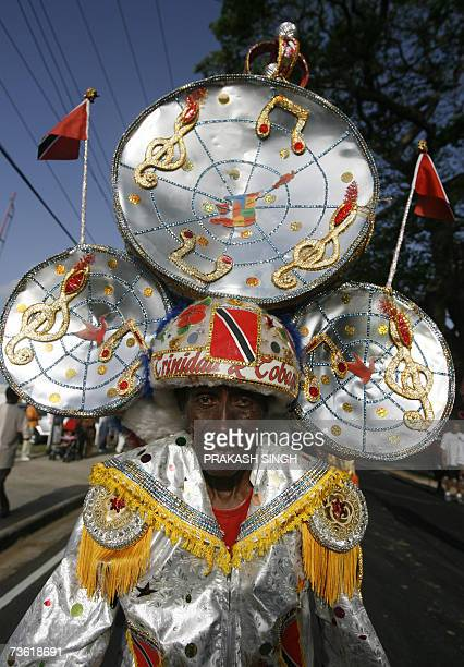 Traditional dancer performs outside the Queen's Park Oval stadium in the Port of Spain in Trinidad and Tobago 17 March 2007 India will play its first...
