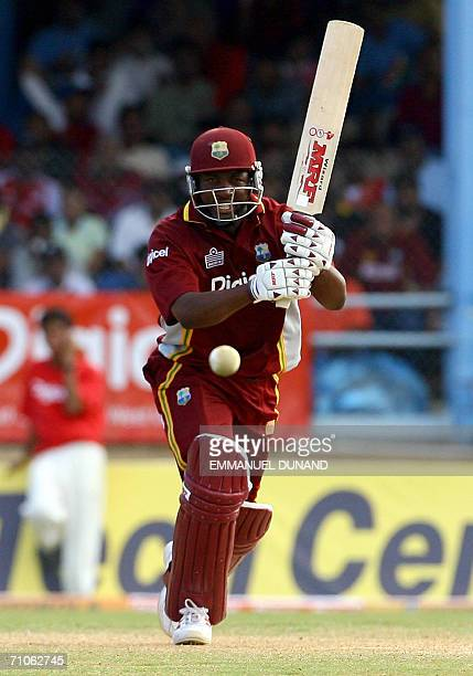 Port-of-Spain, TRINIDAD AND TOBAGO: West Indies cricket team captain Brian Lara eyes the ball going for a four in the fourth One-day International...
