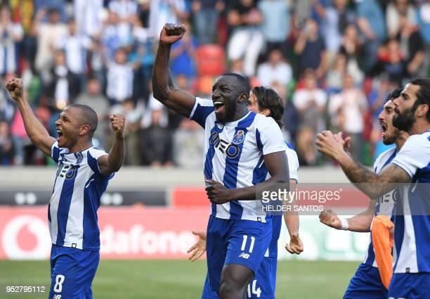 Porto's Algerian forward Yacine Brahimi and Porto's Malian forward Moussa Marega celebrate with teammates after the Portuguese league football match...