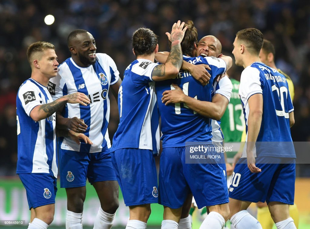 Porto's Algerian forward Yacine Brahimi (2R) celebrates a goal with teammates during the Portuguese league football match FC Porto against Sporting CP at the Dragao stadium in Porto on March 02, 2018. /