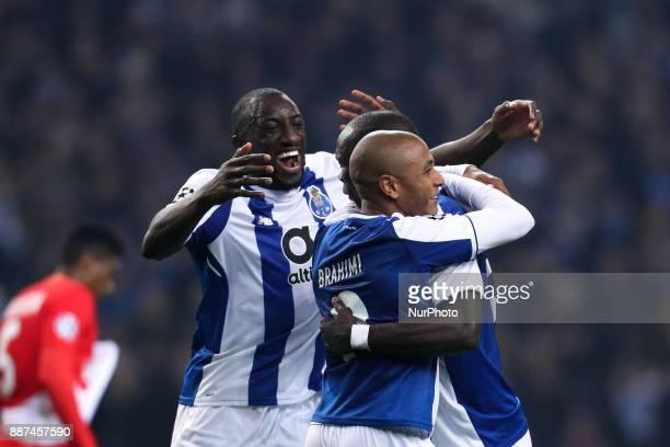 Porto's Algerian forward Yacine Brahimi celebrates after scoring a goal with Porto's Cameroonian forward Vincent Aboubakar and Porto's Malian forward...