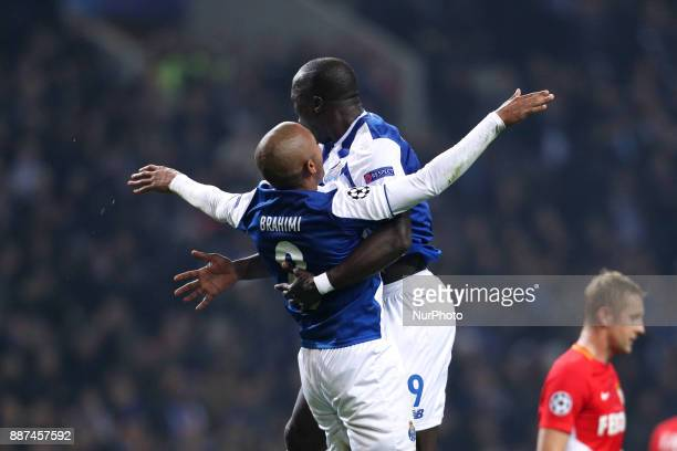 Porto's Algerian forward Yacine Brahimi celebrates after scoring a goal with Porto's Cameroonian forward Vincent Aboubakar during the UEFA Champions...