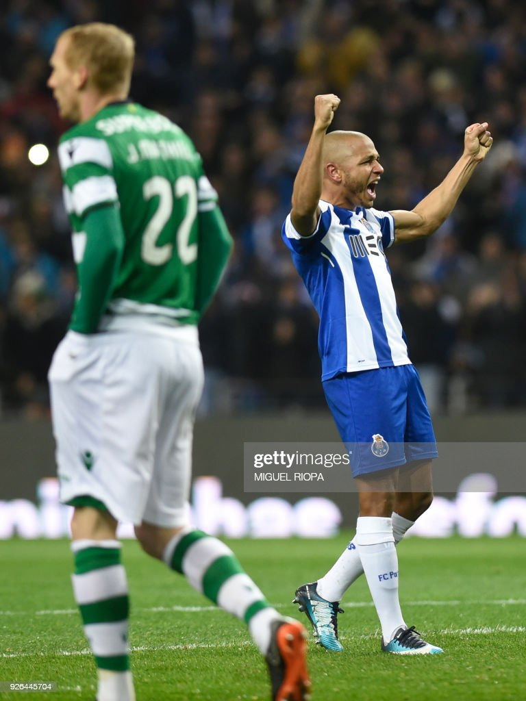Porto's Algerian forward Yacine Brahimi celebrates after scoring a goal during the Portuguese league football match FC Porto against Sporting CP at the Dragao stadium in Porto on March 02, 2018. /
