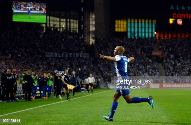 TOPSHOT Porto's Algerian forward Yacine Brahimi celebrates after scoring a goal during the Portuguese league football match between FC Porto and CD...