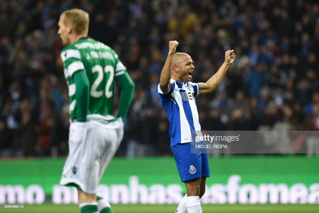 Porto's Algerian forward Yacine Brahimi celebrates scoring a goal during the Portuguese league football match FC Porto against Sporting CP at the Dragao stadium in Porto on March 02, 2018. /