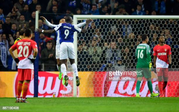 Porto's Algerian forward Yacine Brahimi celebrates with teammate Porto's Cameroonian forward Vincent Aboubakar after scoring a goal during their UEFA...