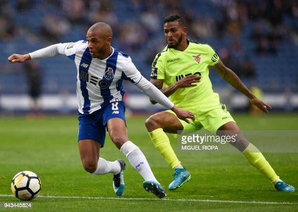 Porto's Algerian forward Yacine Brahimi challenges Aves' Brazilian midfielder Nildo Petrolina during the Portuguese league football match between FC...