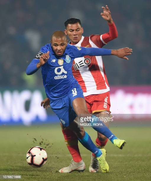 Porto's Algerian forward Yacine Brahimi challenges CD Aves' Brazilian midfielder Claudio Falcao during the Portuguese League football match between...