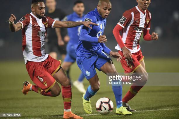 Porto's Algerian forward Yacine Brahimi challenges CD Aves' Brazilian defender Vitor Costa during the Portuguese League football match between CD...