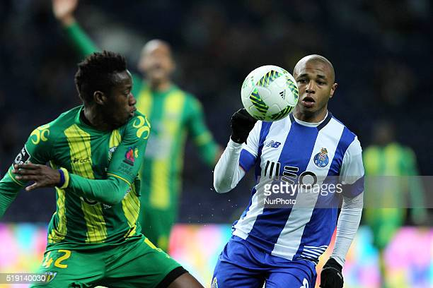 Porto's Algerian forward Yacine Brahimi in action with CD Tondela's Gabon defender Junior Otoo during the Premier League 2015/16 match between FC...