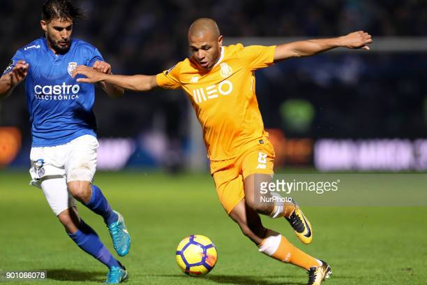 Porto's Algerian forward Yacine Brahimi in action with Feirense's Portuguese forward Hugo Seco during the Premier League 2016/17 match between CD...