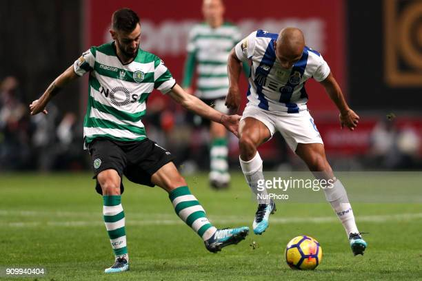 Porto's Algerian forward Yacine Brahimi in action with Sporting's defender Piccini during the Portuguese League Cup 2017/18 match between Sporting CP...