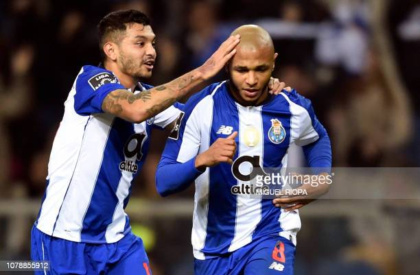 Porto's Algerian forward Yacine Brahimi is congratulated by teammate Mexican forward Jesus Corona after scoring a goal during the Portuguese League...