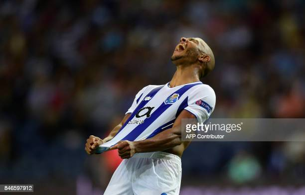 TOPSHOT Porto's Algerian forward Yacine Brahimi reacts after loosing a chance to scoreduring the UEFA Champions League football match FC Porto vs...