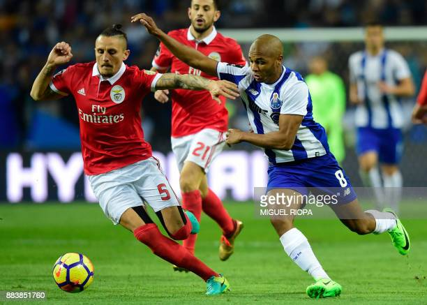 Porto's Algerian forward Yacine Brahimi vies with Benfica's Serbian midfielder Ljubomir Fejsa during the Portuguese league football match FC Porto vs...