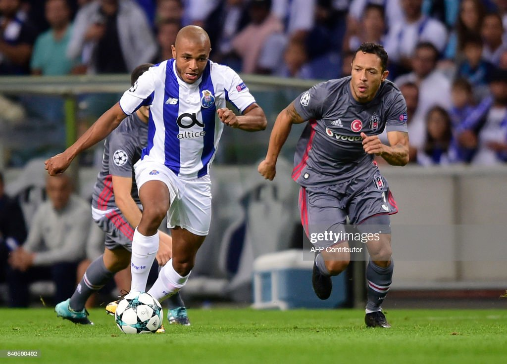 Porto's Algerian forward Yacine Brahimi (L) vies with Besiktas' Brazilian defender Adriano Correia during the UEFA Champions League football match FC Porto vs Beskitas JK at the Dragao stadium in Porto on September 13, 2017. /
