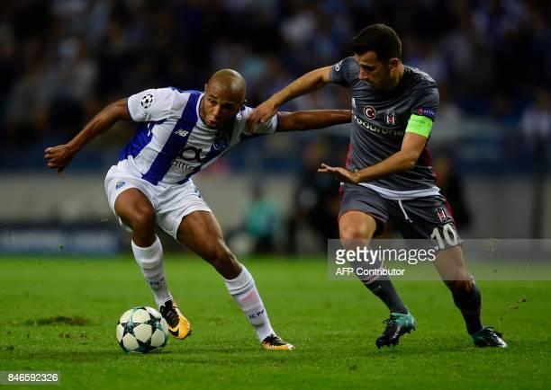 Porto's Algerian forward Yacine Brahimi vies with Besiktas' midfielder Oguzhan Ozyakup during the UEFA Champions League football match FC Porto vs...