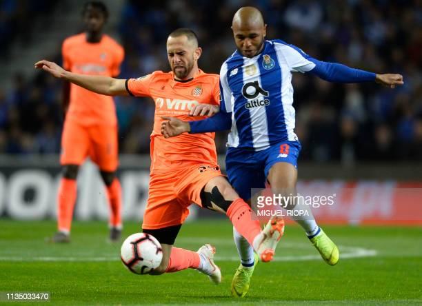 Porto's Algerian forward Yacine Brahimi vies with Boavista's Brazilian midfielder Rafael Costa during the Portuguese league football match between FC...