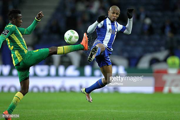 Porto's Algerian forward Yacine Brahimi vies with CD Tondela's Gabon defender Junior Otoo during the Premier League 2015/16 match between FC Porto...