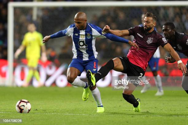Porto's Algerian forward Yacine Brahimi vies with Feirense's Portuguese defender Diga during the Premier League 2018/19 match between FC Porto and CD...