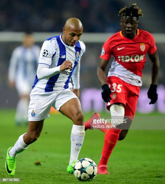 Porto's Algerian forward Yacine Brahimi vies with Monaco's French defender Kevin N'Doram during the UEFA Champions League group G football match FC...