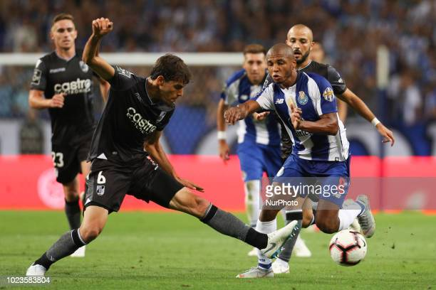 Porto's Algerian forward Yacine Brahimi vies with Vitoria SC's Portuguese defender Joao Afonso during the Premier League 2018/19 match between FC...