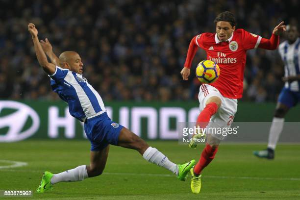 Porto's Algerian forward Yacine Brahimi with Benfica's Croatian midfielder Filip Krovinovic during the Premier League 2016/17 match between FC Porto...