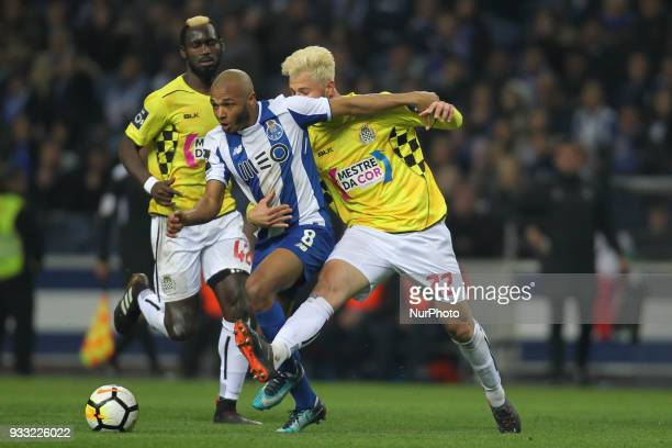 Porto's Algerian forward Yacine Brahimi with Boavista's Portuguese defender Carlos Santos during the Premier League 2017/18 match between FC Porto v...