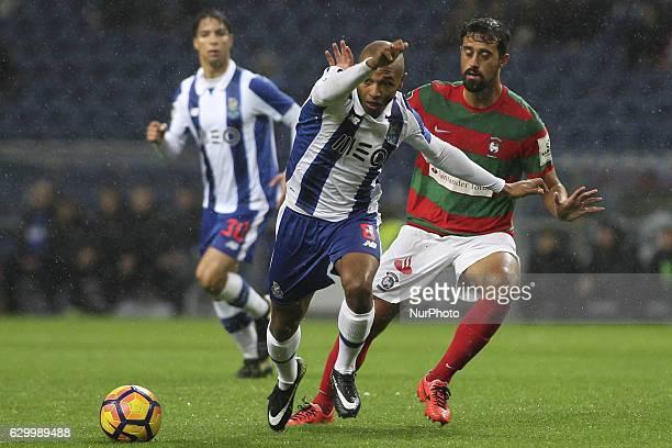 Porto's Algerian forward Yacine Brahimi with Maritimo's Brazil defender Mauricio Antonio during the Premier League 2016/17 match between FC Porto and...