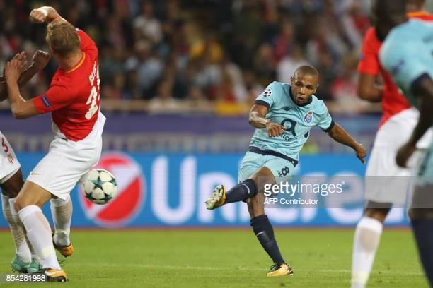 Porto's Algerian midfielder Yacine Brahimi shoots on goal during the UEFA Champions League Group G football match AS Monaco FC vs FC Porto on...