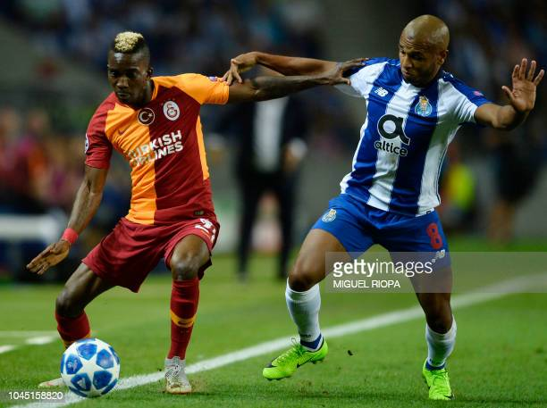 Porto's Algerian midfielder Yacine Brahimi vies with Galatasaray's Nigerian forward Henry Onyekuru during the UEFA Champions League group D football...