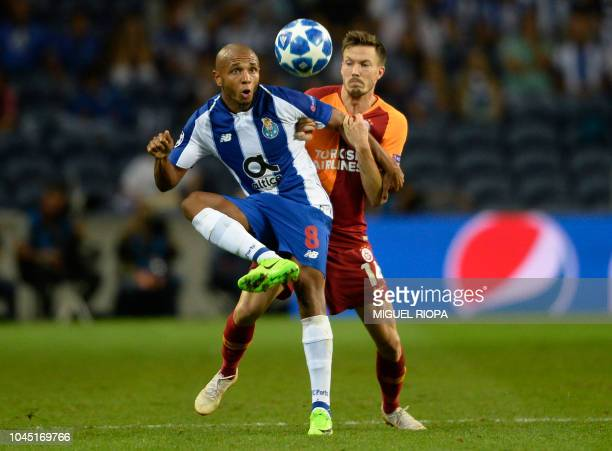 Porto's Algerian midfielder Yacine Brahimi vies with Galatasaray's Norwegian defender Martin Linnes during the UEFA Champions League group D football...