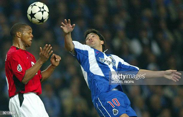 Porto's Anderson de Souza Deco jumps for the ball with Manchester United's South African Quinton Fortune during the champions league football match...