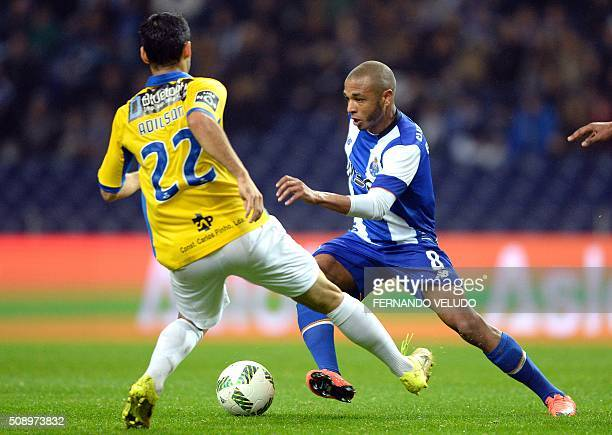 Porto's Argelian forward Yacine Brahimi vies with Arouca's Brazilian midfielder Adilson Filho during the Portuguese League football match FC Porto vs...